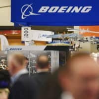 The Boeing logo is seen at its stand during the the 70th annual International Astronautical Congress at the Walter E. Washington Convention Center in Washington Tuesday. | AFP-JIJI