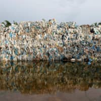 Plastic waste piled outside an illegal recycling factory in Jenjarom, Kuala Langat, Malaysia, is seen last October. | REUTERS