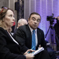 Clotilde Delbos, now Renault's interim CEO, gives a news conference in Paris in October 2017 with Carlos Ghosn, then the Renault chairman. | BLOOMBERG