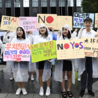 High school students take part in a rally in Seoul in July calling for the public to boycott Japan-made products in response to Tokyo's tightening of export controls on South Korea. | KYODO