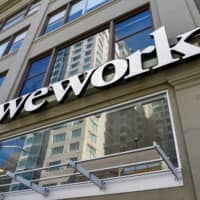 A WeWork logo is seen outside its offices in San Francisco last month.   REUTERS