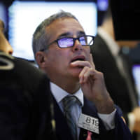 Specialist Anthony Rinaldi works on the floor of the New York Stock Exchange Tuesday. Stocks are opening lower on Wall Street as tensions rose between Washington and Beijing just ahead of the latest round of trade talks. | AP