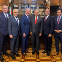 Mexican President Andres Manuel Lopez Obrador (center) poses with House Ways and Means Committee Chairman Richard E. Neal (third, left) and members of the Congressional Delegation Dan Kildee (left), Bill Pascrell (second, left), Jimmy Panetta (second, right) and Jimmy Gomez during a meeting on the United States-Mexico-Canada Agreement (USMCA), at the National Palace in Mexico City Tuesday. | PRESS OFFICE ANDRES MANUEL LOPEZ OBRADOR / HANDOUT / VIA REUTERS