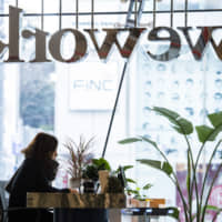 A woman works in a WeWork shared-office space in Tokyo. | BLOOMBERG