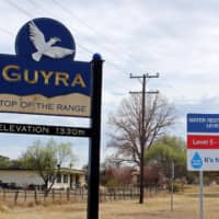A sign indicating the water restriction level as a result of a drought stands in Guyra, in New South Wales, Australia, on Sept. 25. | REUTERS