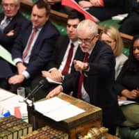 A handout picture released by the U.K. Parliament shows Britain's main opposition Labour Party leader, Jeremy Corbyn, speaking in the House of Commons in London on Tuesday at the opening of debate into the Brexit withdrawal agreement bill. British Prime Minister Boris Johnson threatened Tuesday to abandon ratifying his Brexit deal and instead seek an early election if MPs defy his timetable to get the agreement passed in time to leave the EU on Oct. 31. | UK PARLIAMENT / JESSICA TAYLOR / VIA AFP-JIJI
