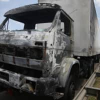 A gutted truck is seen after an armed gang robbed a securities company at the Viracopos airport freight terminal, in Campinas near Sao Paulo Thursday.   REUTERS