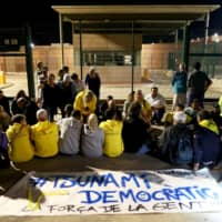 Protesters gather outside Lledoners jail in support of the jailed Catalan separatist leaders, in Sant Joan de Vilatorrada, north of Barcelona, Spain, Sunday. | REUTERS