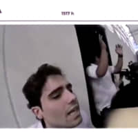 Ovidio Guzman, son of drug cartel kingpin Joaquin 'El Chapo' Guzman, is briefly captured by Mexican military police in a residential compound near the center of Culiacan in the state of Sinaloa, Mexico Oct. 17 in this still image taken from a helmet camera footage obtained Wednesday. | MEXICAN GOVERNMENT TV / HANDOUT / VIA REUTERS