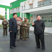 This undated picture released Sunday by North Korea's official Korean Central News Agency shows North Korean leader Kim Jong Un visiting a medical appliances factory in Myohyangsan, North Korea. | AFP-JIJI