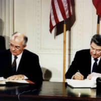 Late U.S. President Ronald Reagan (right) and then-Soviet leader Mikhail Gorbachev sign the Intermediate-Range Nuclear Forces (INF) treaty in the White House on Dec. 8, 1987. | REUTERS