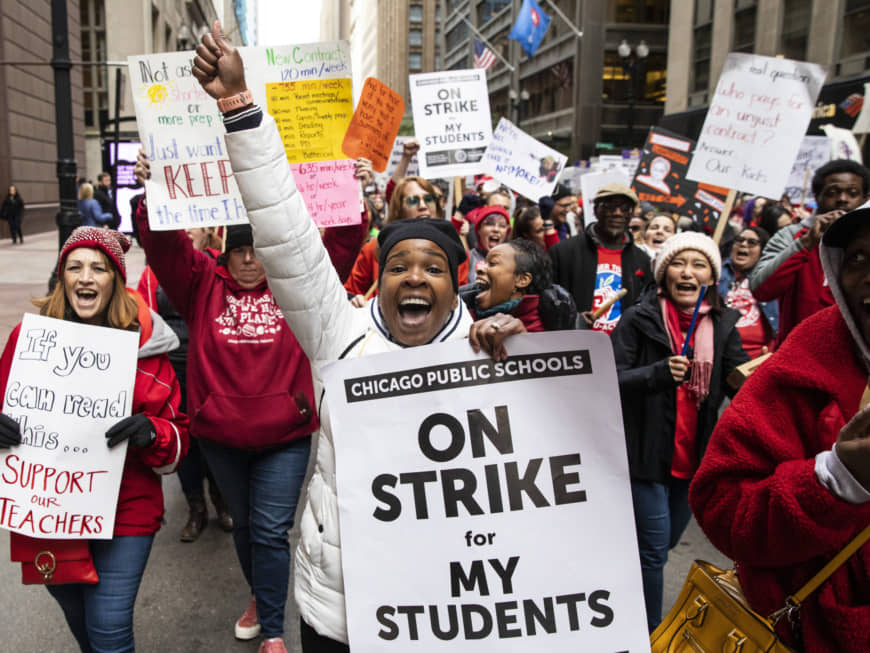 Thousands of striking Chicago Teachers Union members and their supporters march through the Loop Thursday in Chicago. Striking teachers went on strike after their union and city officials failed to reach a contract deal in the nation's third-largest school district. | ASHLEE REZIN GARCIA / CHICAGO SUN-TIMES / VIA AP