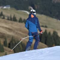 A man skis on man-made snow in Austria this week. Carbon emissions from fossil fuels hit a record last year, but estimates vary of how much it would cost to meet the Paris target of keeping the global temperature rise to within 2 degrees.  | REUTERS