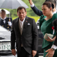 Rodrigo Duterte, the Philippine president, arrives for Emperor Naruhito's enthronement ceremony at the Imperial Palace in Tokyo Tuesday. | BLOOMBERG