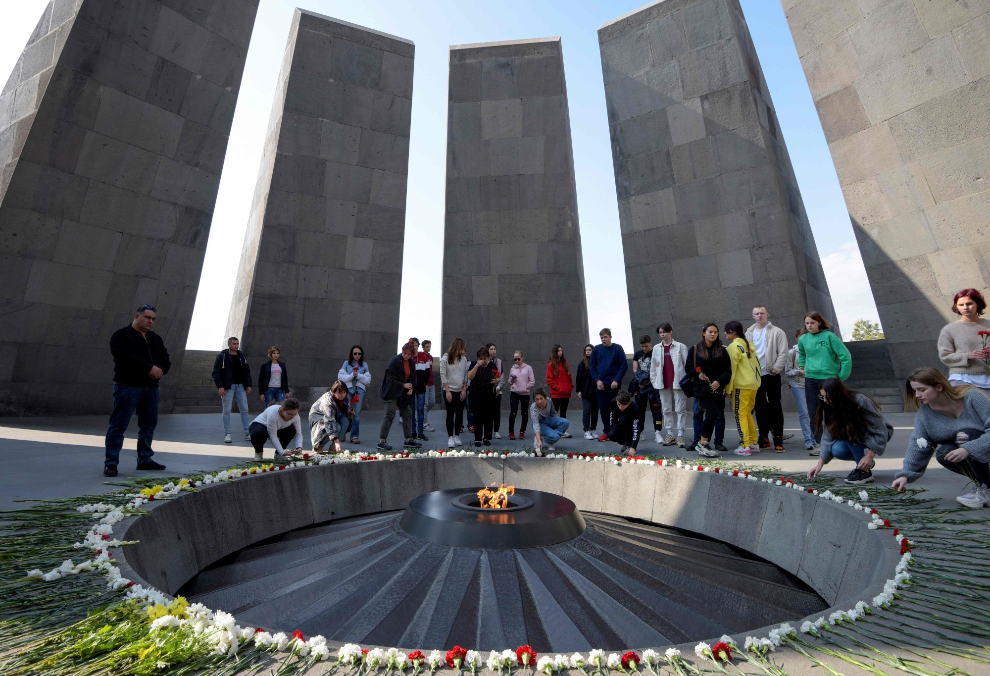 People visit the Tsitsernakaberd Armenian Genocide Memorial in Yerevan Wednesday. Armenians rejoiced over the historic vote in the U.S. House of Representatives that recognized as 'genocide' mass killings of ethnic Armenians in the Ottoman Empire a century ago. | AFP-JIJI