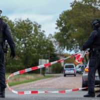 Police secure an area in Wiedersdorf near Landsberg and Halle, eastern Germany, where shots were fired on Wednesday. At least two people were killed in a shooting on a street in Halle, police said, adding that the perpetrators were on the run.   AFP-JIJI