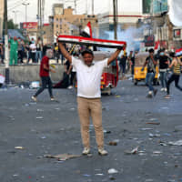 Anti-government protesters gather in Tahrir Square during a demonstration in Baghdad Sunday,. Protests have resumed in Iraq after a wave of anti-government protests earlier this month were violently put down.   AP