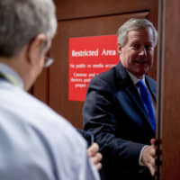 Rep. Mark Meadows speaks to reporters as he arrives for a closed-door meeting on Capitol Hill in Washington Tuesday as Deputy Assistant Secretary of State George Kent testifies before congressional lawmakers as part of the House impeachment inquiry into President Donald Trump. | AP