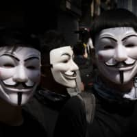 Protesters wearing masks prepare to march in the Wanchai area of Hong Kong on Tuesday. | AFP-JIJI