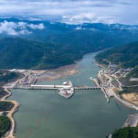 New Mekong dam in Laos opens to protests from villagers in Thailand