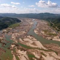 This screengrab from an aerial video taken on Monday shows the Mekong River in Sungkom district in Nong Khai province, more than 300 km from the Xayaburi dam. | AFP-JIJI
