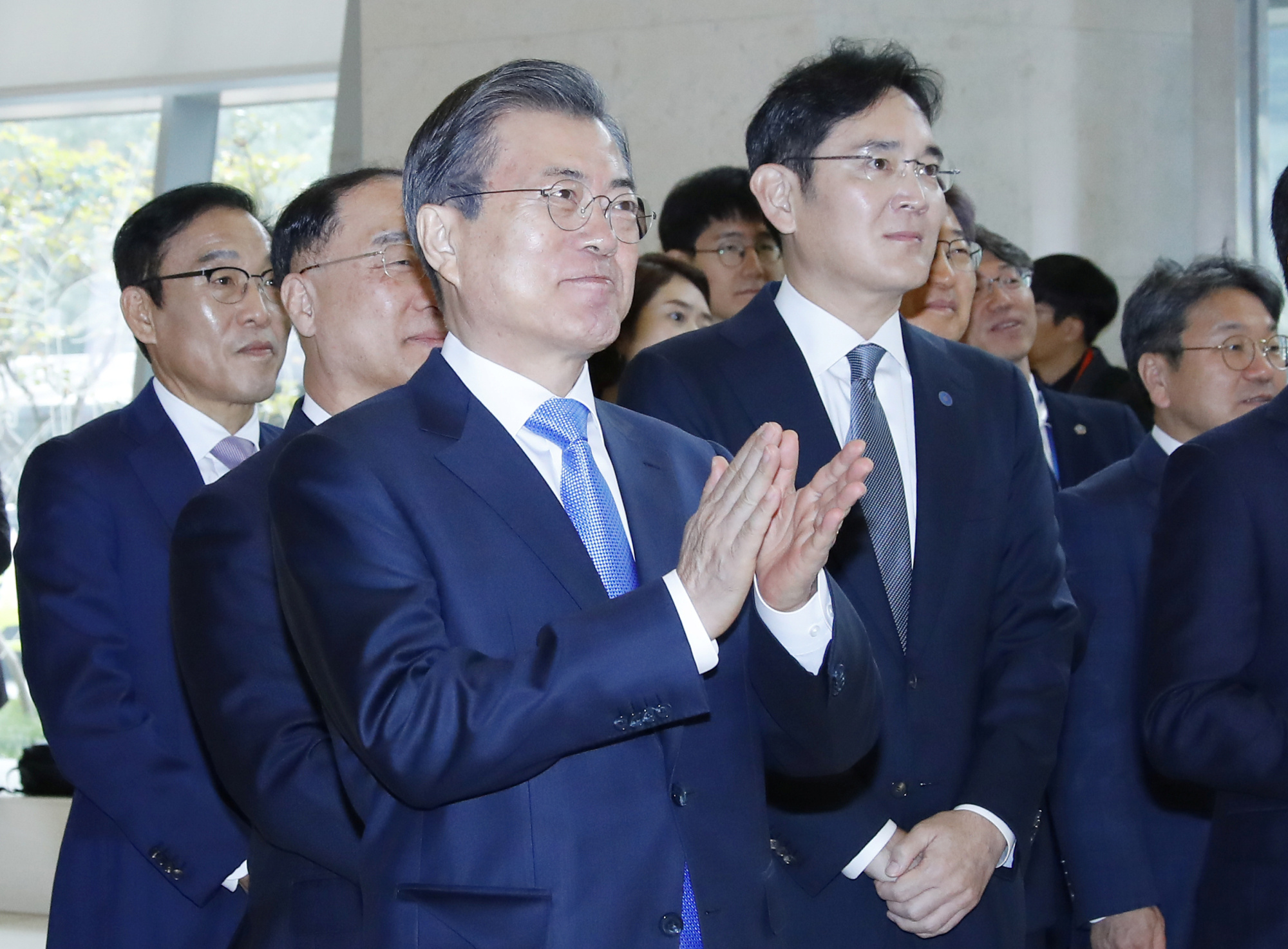 South Korean President Moon Jae-in and Samsung Electronics Vice Chairman Jay Y. Lee look around Samsung Display's factory in Asan, South Korea, on Thursday.   YONHAP / VIA REUTERS