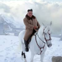 North Korean leader Kim Jong Un rides a horse in the snow on Mount Paektu in this image released Wednesday. | KCNA / VIA REUTERS