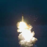A photo carried by North Korea's Rodong Sinmun newspaper in August 2016 shows an underwater launch test of a submarine-launched ballistic missile. | KYODO