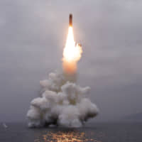 What appears to be a submarine-launched ballistic missile rises into the air in this undated picture released by North Korea's Central News Agency on Wednesday.   REUTERS