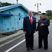 U.S. President Donald Trump and North Korean leader Kim Jong Un talk before a meeting at the Demilitarized Zone in Panmunjom, South Korea, on June 30.   AFP/GETTY IMAGES