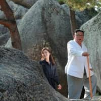 Wife of North Korea's Kim makes first public appearance in nearly four months