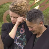 In this image taken from video, British High Commissioner Laura Clarke wipes away a tear after hugging a Maori elder during a visit to the town of Gisborne, in New Zealand, on Wednesday. Clarke expressed 'regret' that British explorers killed some of the first indigenous Maori they met 250 years ago. She met with Maori tribal leaders in the town as New Zealand marked the anniversary of Capt. James Cook and the crew of his ship Endeavour's arrival in 1769. | AP