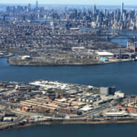 The Rikers Island Prison complex (foreground) is seen from an airplane in the Queens borough of New York City in 2017. | REUTERS
