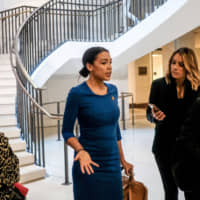 Rep. Alexandria Ocasio-Cortez, a Democrat from New York, speaks to members of the media while arriving for closed-door testimony before House committees with Gordon Sondland, U.S. ambassador to the European Union, on Capitol Hill in Washington on Thursday.   BLOOMBERG