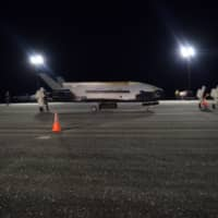 The U.S. Air Force's X-37B Orbital Test Vehicle Mission 5 is seen after landing at NASA's Kennedy Space Center Shuttle Landing Facility, Florida, Sunday.   U.S. AIR FORCE / HANDOUT / VIA REUTERS
