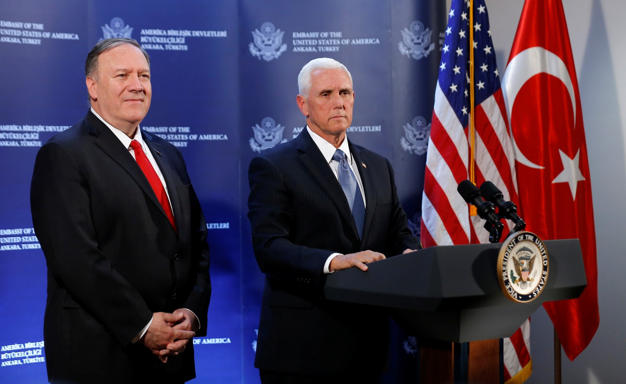 U.S. Vice President Mike Pence and U.S. Secretary of State Mike Pompeo attend a news conference at the U.S. Embassy in Ankara Thursday.   REUTERS