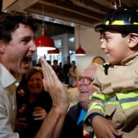 In election fight, Canada's Trudeau says he needs voter support to stand up to Trump