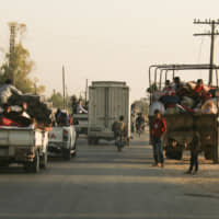 Civilians flee Syrian border towns as Turkish forces pound 'terror corridor' targets after U.S. pullout