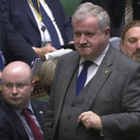 Ian Blackford, the Scottish Nationalist Party's leader in Westminster, speaks in the House of Commons during a Brexit debate on Tuesday. | AP