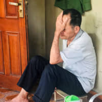 Chinh Nguyen, father of Nguyen Phan Thang, who is belieed to have been among the 39 people found dead in a truck container last week in the U.K., sits at home in Ha Tinh province, Vietnam, Sunday. | REUTERS