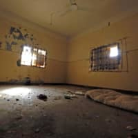 This January photo shows a view inside a former Islamic State (IS) group prison cell in the city of Hajin in Syria's eastern Deir Ezzor province, vacated after the Kurdish-led and U.S.-backed Syrian Democratic Forces (SDF) retook the city from Islamic State group fighters. More than 100 prisoners of the Islamic State extremist movement have escaped in Syria in the chaos since Turkey's incursion, a senior U.S. official said Wednesday. 'We would say the number is now over 100. We do not know where they are,' James Jeffrey, the State Department pointman on Syria, told the House Foreign Affairs Committee. | AFP-JIJI