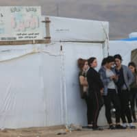 Displaced people from the Yazidi religious minority are seen at the Sharya camp in Duhok, Iraq, Tuesday. | REUTERS