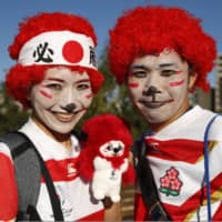 Japan fans outside the the International Stadium Yokohama before the stadium Japan vs Scotland game. | REUTERS