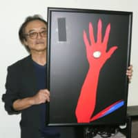Toshihiko Hanai shows his artwork containing an erased image of a statue of a girl symbolizing 'comfort women' on Thursday in Ise, Mie Prefecture. | KYODO