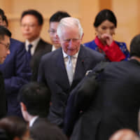 Prince Charles of the U.K. attends a banquet hosted by Prime Minister Shinzo Abe and his wife, Akie, in Tokyo on Wednesday.   REUTERS