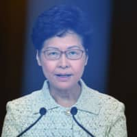 Hong Kong Chief Executive Carrie Lam takes part in her weekly news conference in the city on Oct. 15. | AFP-JIJI