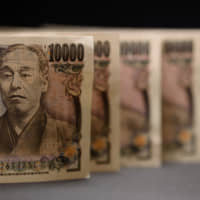 Cash has lost its luster for investors in Japanese stocks. | BLOOMBERG