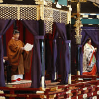 Emperor Naruhito delivers the speech proclaiming his enthronement from the takamikura imperial throne Tuesday at the Imperial Palace in Tokyo. | KYODO