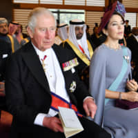 Prince Charles of the United Kingdom and Crown Princess Mary of Denmark watch the ceremony at the Imperial Palace. | KYODO