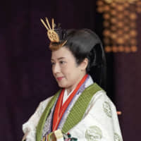 Empress Masako departs from the ceremony hall following Emperor Naruhito's proclamation  of his enthronement. | AP
